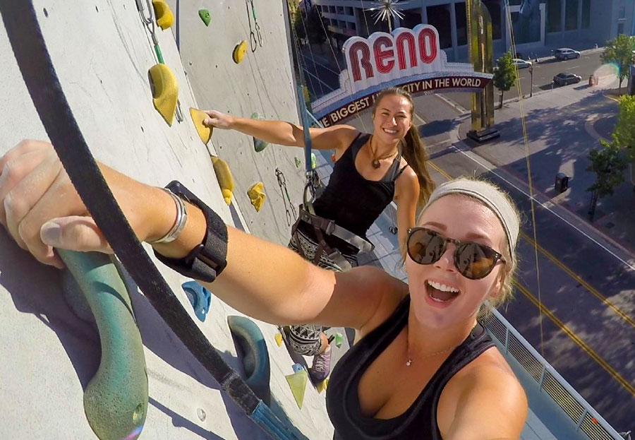 Women enjoy rock climbing in Downtown Reno.